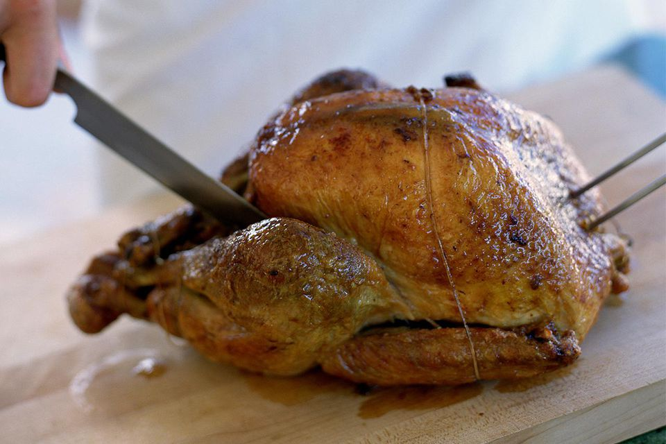 Chef carving roasted chicken