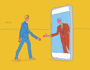 Two men shaking hands through smartphone.