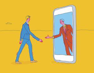 Two men shaking hands through smartphone.