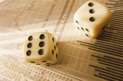 Dice on stock market report that shows historical market returns.