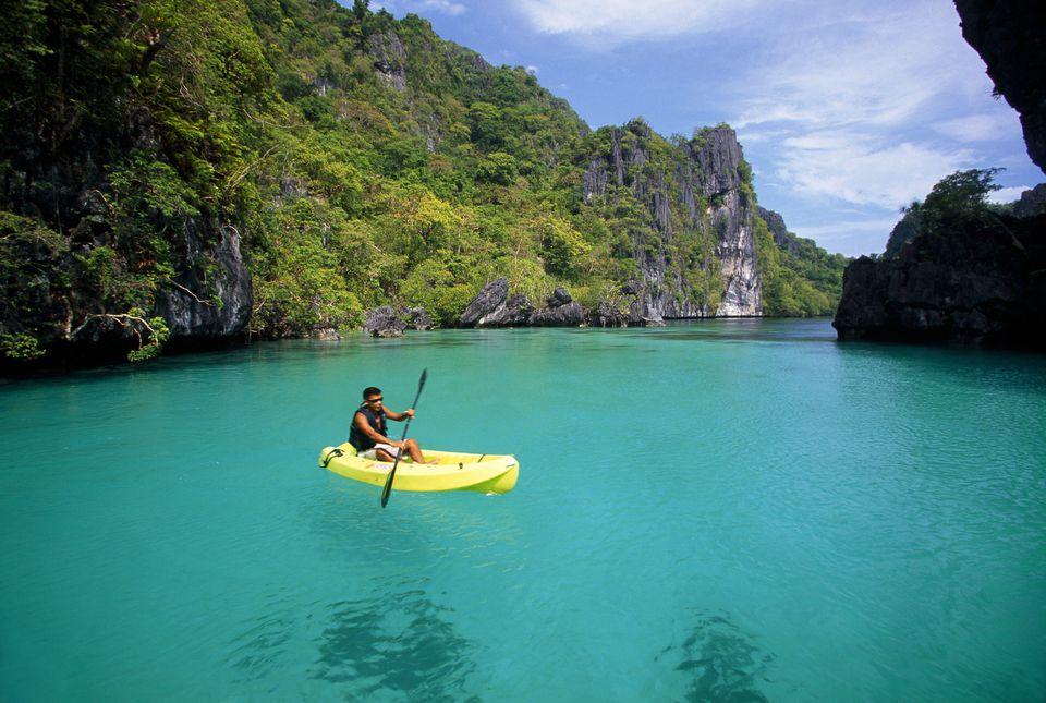Kayaker in Big Lagoon at Miniloc Island, El Nido, Philippines