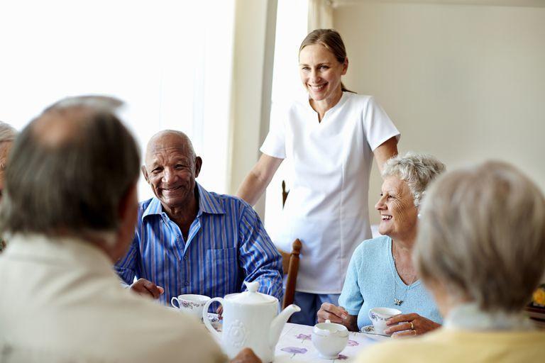 Nurse and nursing home patients share tea