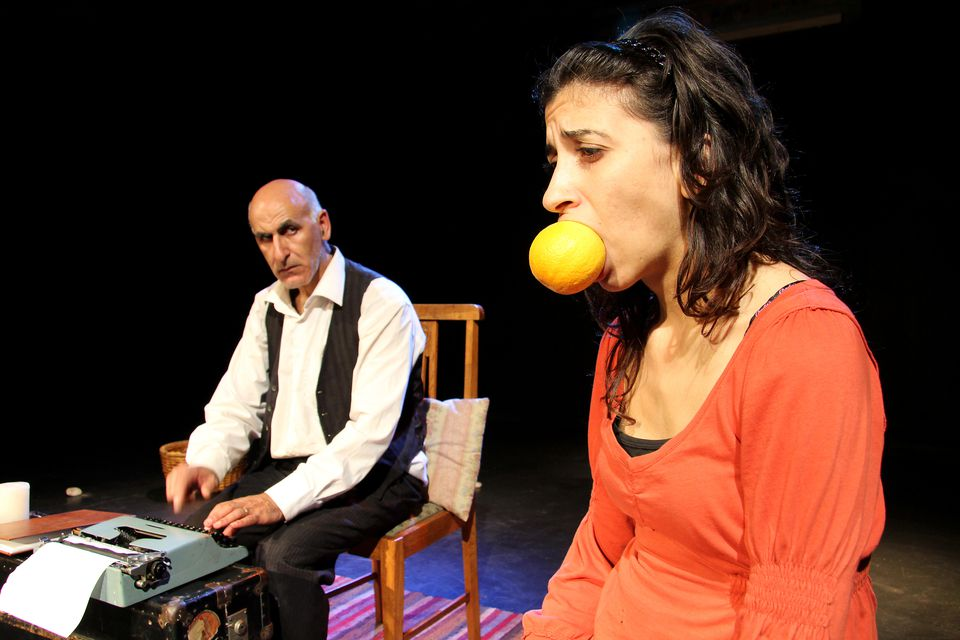 A man and a woman on stage as part of a play