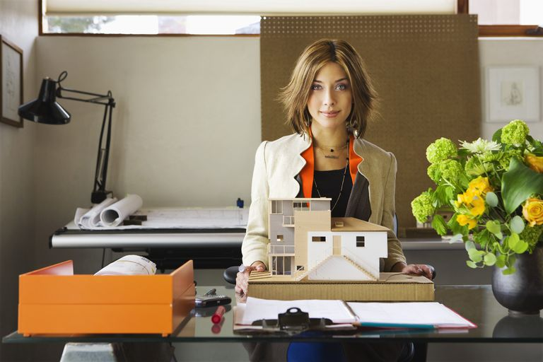 An architect presents a custom designed architectural model