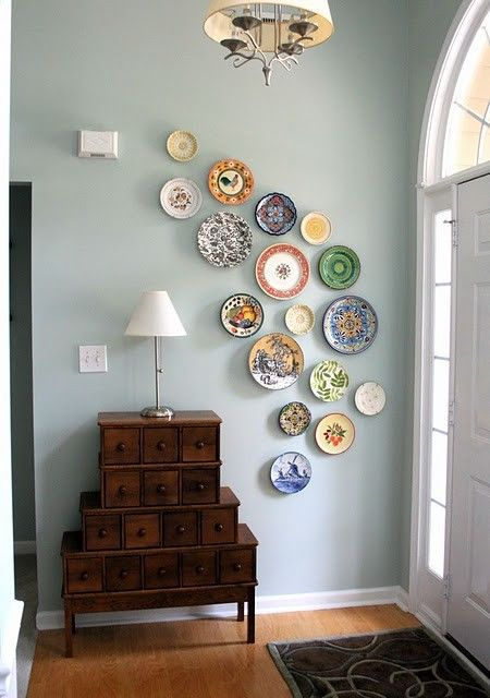 Colorful dishes displayed along a wall