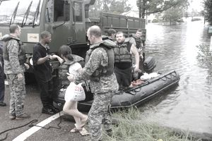 National Guard assisting woman