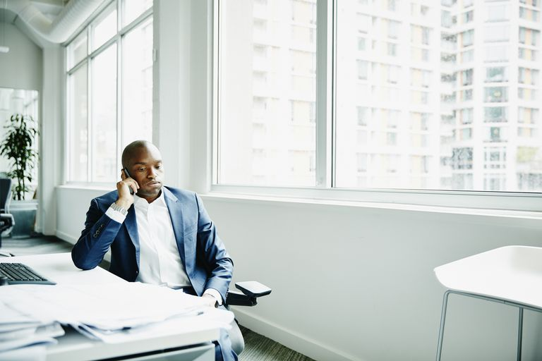 stressed businessman on telephone in office