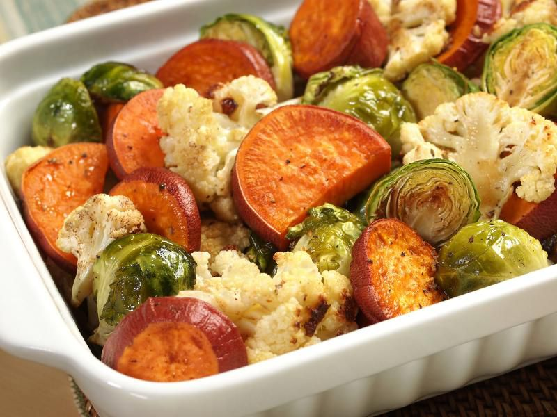 Oven-roasted sweet potatoes with cauliflower and Brussels sprouts in a maple glaze