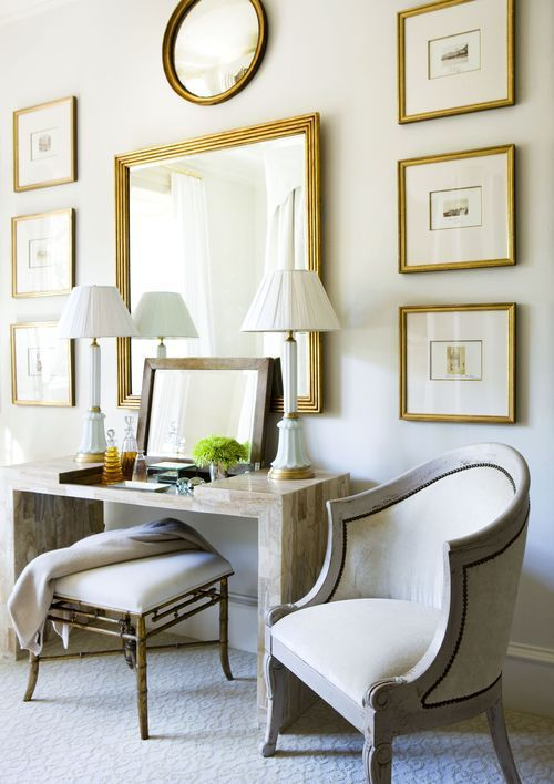 Framed gallery wall with large mirror centerpiece