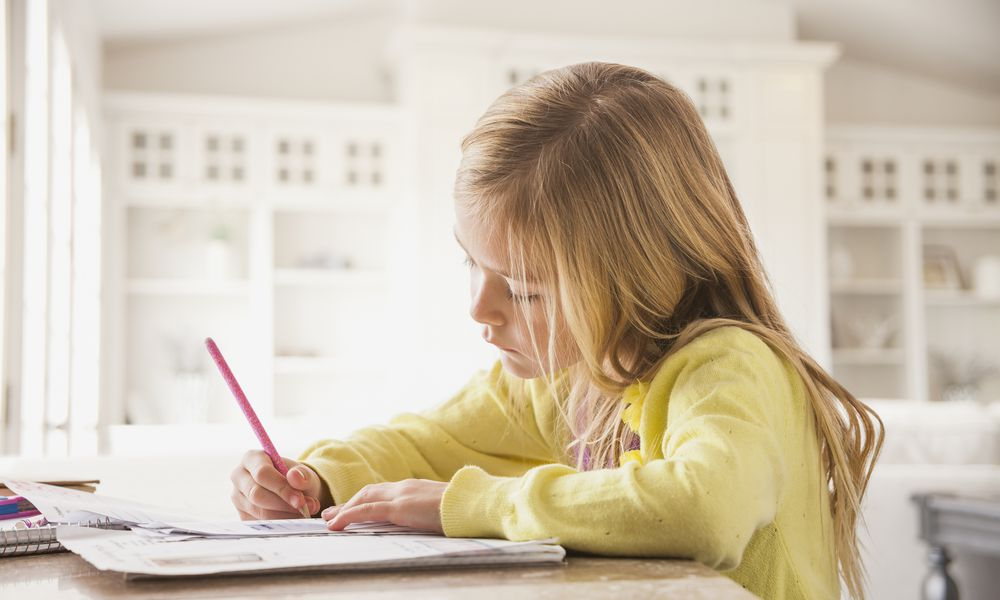 A young girl doing her work.