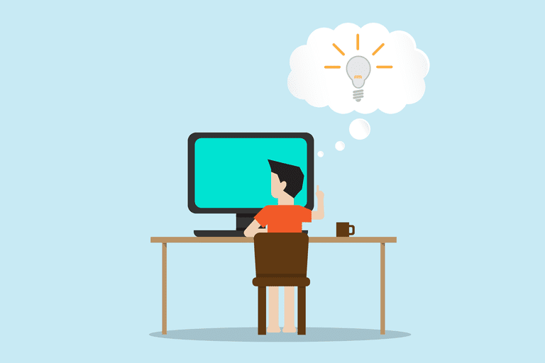 man at computer having an idea
