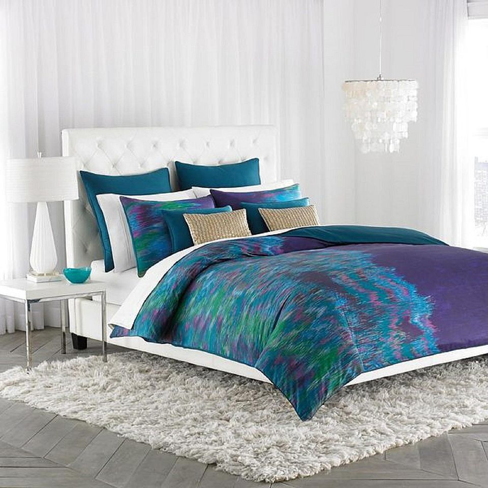 Purple, green and blue comforter set.