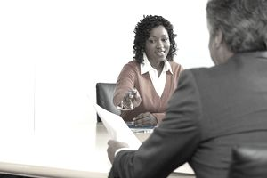 Woman and man in business meeting