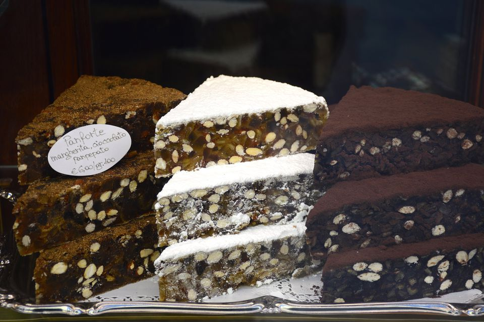 Three types of panforte in a Tuscan shop window