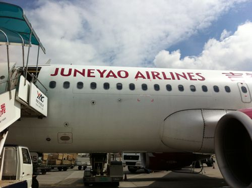 Boarding a Juneyao Airlines plane in Shanghai