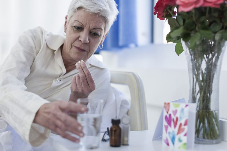 Patient in hospital taking medication