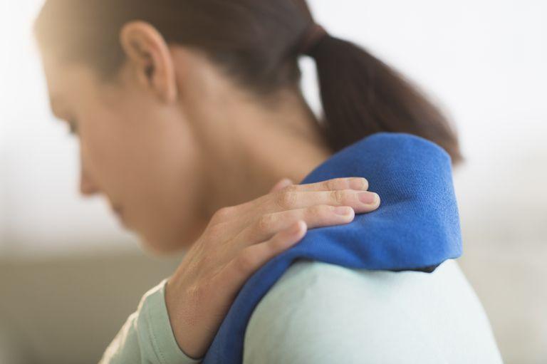 USA, New Jersey, Jersey City, Woman touching aching back