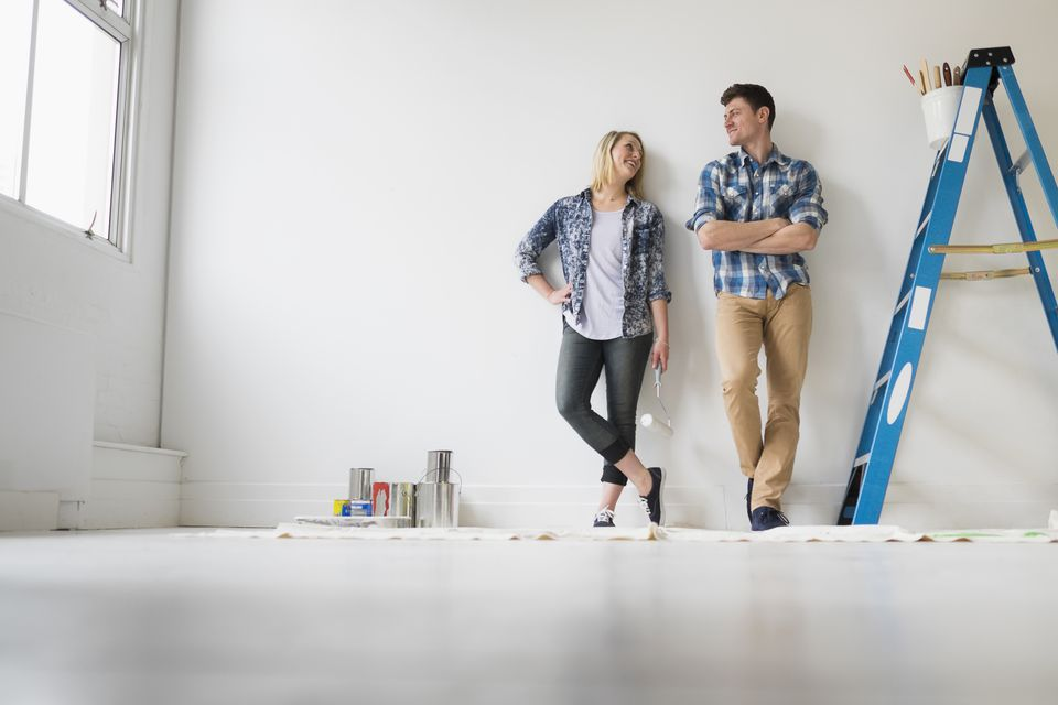 Couple painting room white