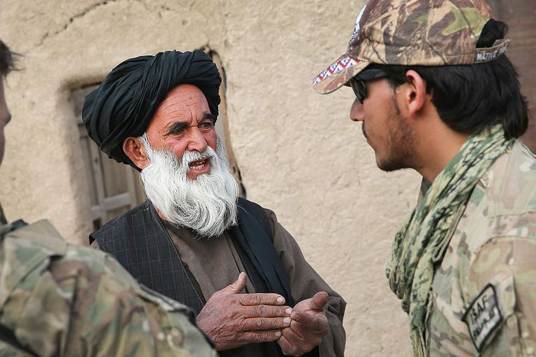 Afghan interpreter with the U.S. Army's 4th squadron 2d Cavalry Regiment helps to question a villager