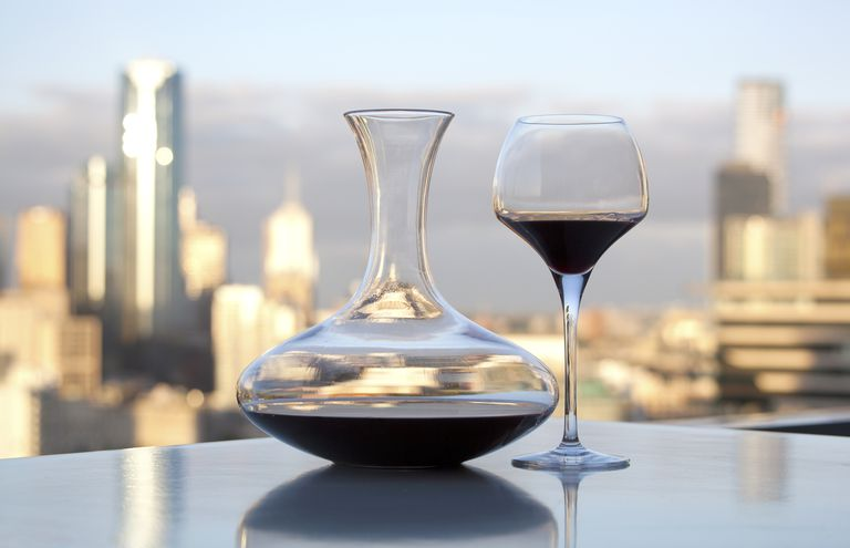 A wine decanter keeps solids and particulates in its wide portion so the poured wine is clean liquid.