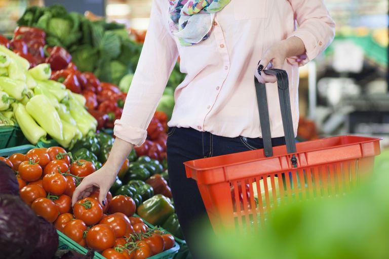 Woman taking tomato