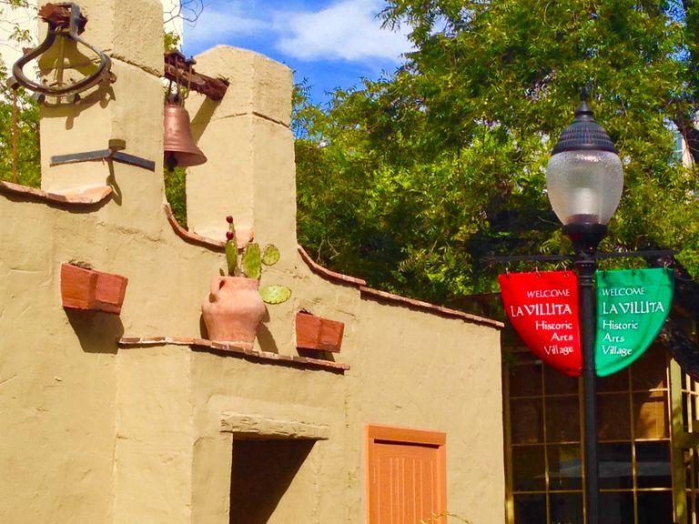 Pueblo architecture, with pottery and flags, La Villita in San Antonio, Texas