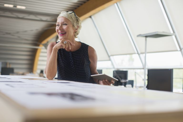 mature woman working in office