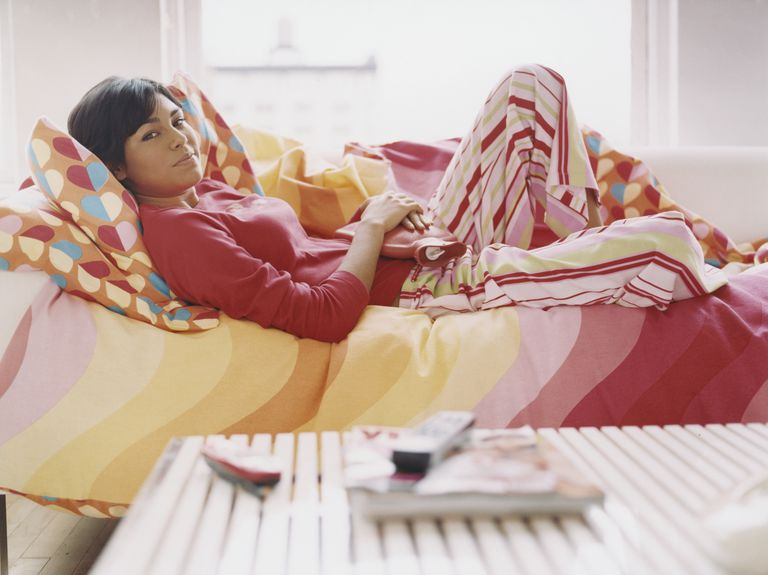 Woman in bed with heating pad