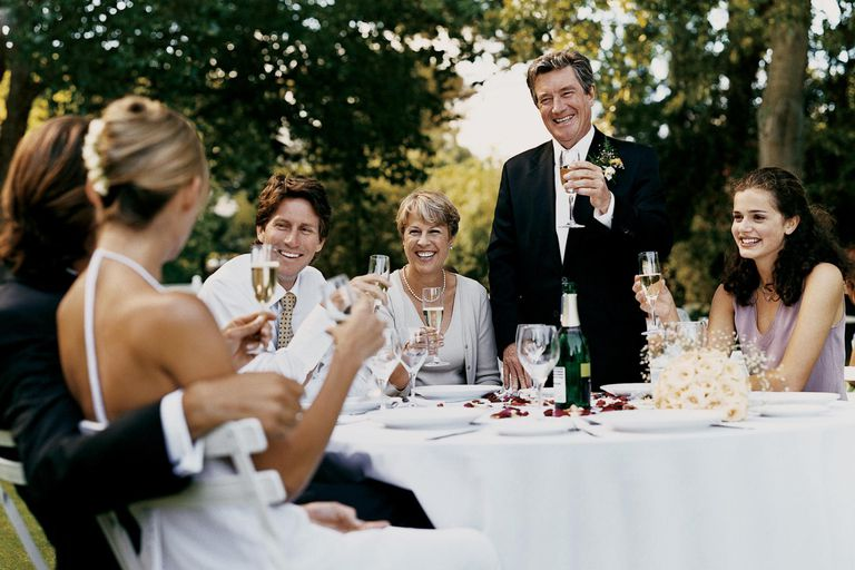 Father Giving a Proposing a toast to the Bride and Groom at a Wedding Reception in a Garden