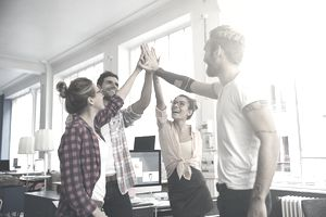 young business entrepreneurs celebrating a success
