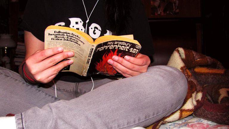 Teen reading Farenheit 451 book.