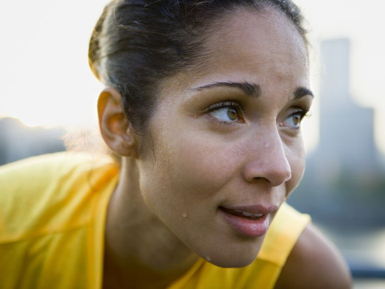 Close-up of woman sweating