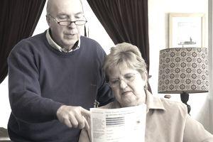 Senior couple reading Social Security form