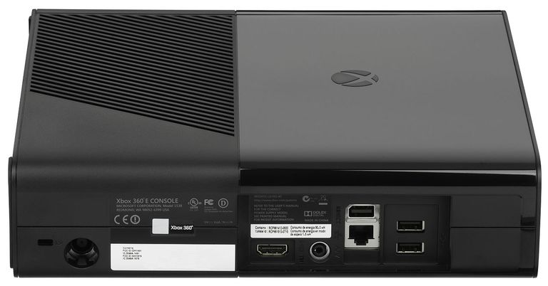 The Xbox 360 E, the third hardware revision in the Xbox 360 lineup. This picture shows the back of the unit and its inputs and outputs.