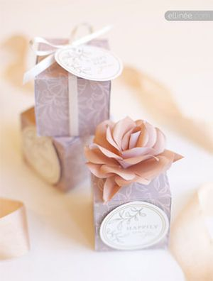 Purple and white wedding favor boxes.