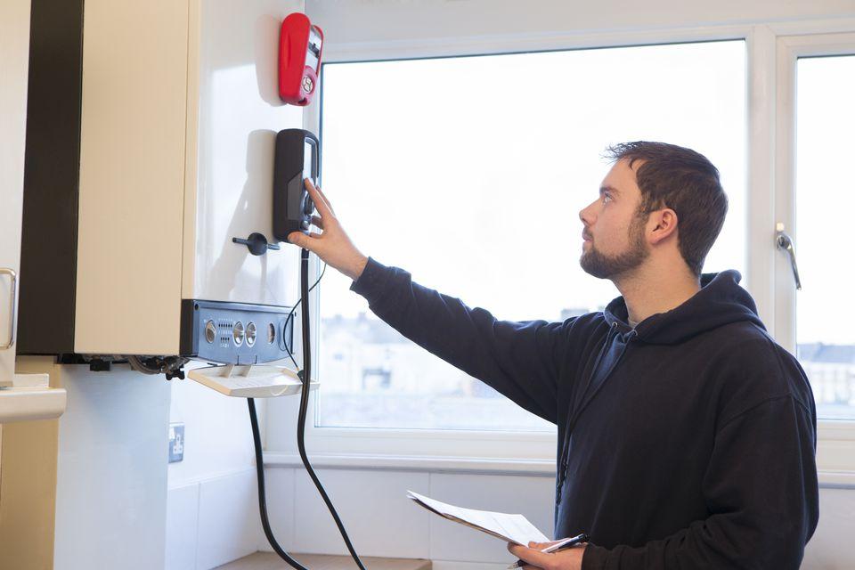 Technician servicing boiler