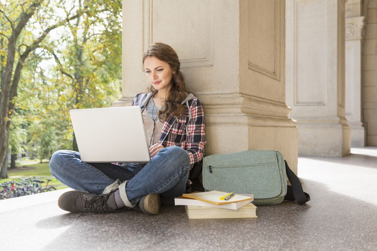 female college student working on laptop