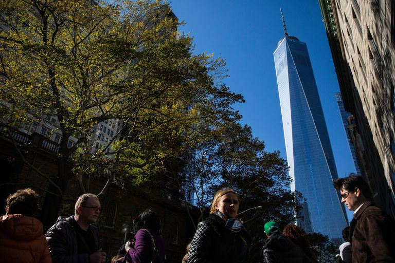 One World Trade Center, completed, seen from a park near Broadway, with pedestrians