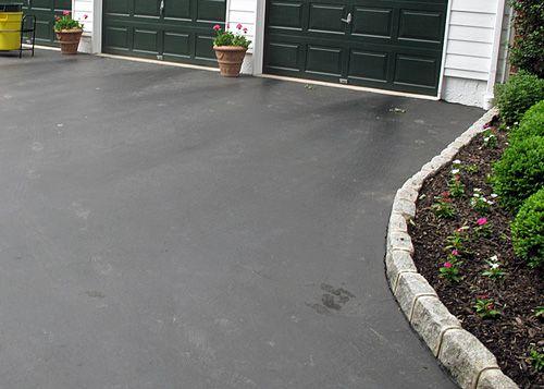 asphalt driveway edging with cobblestone pavers