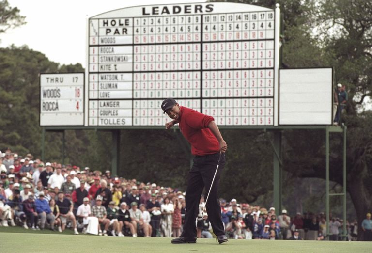 Tigers Woods hits a four foot putt on the 18th hole to win the Masters Tournament at the Augusta National Golf Course in Augusta, Georgia