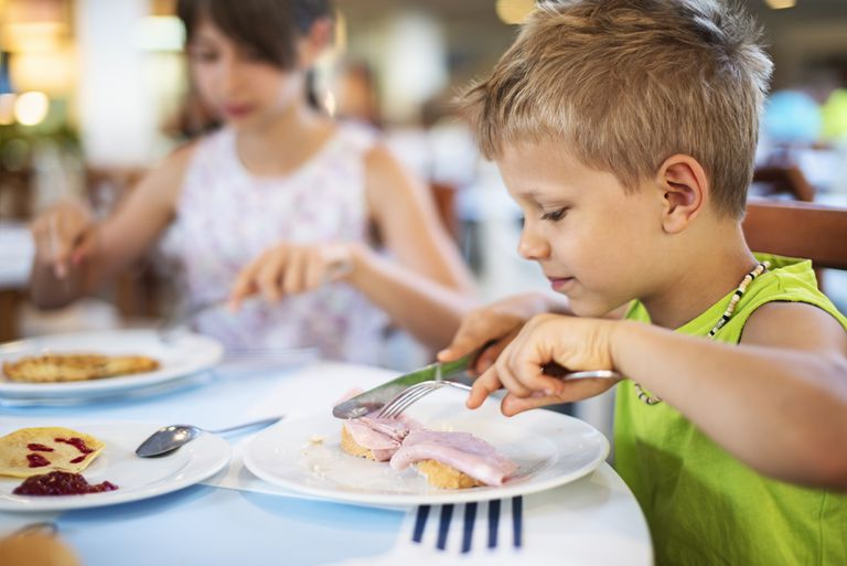 Kids eating at a restaurant.