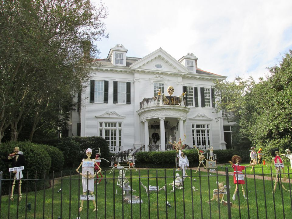 skeleton decorations in the yard of a large white house in new orleans - New Orleans Halloween Parties