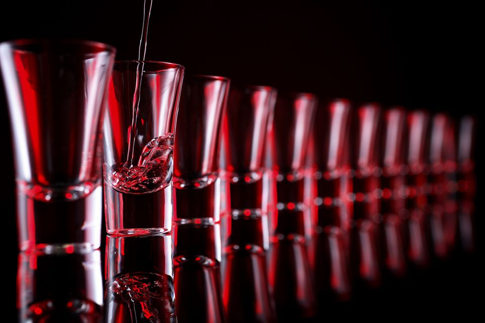 A row of red shot glasses.