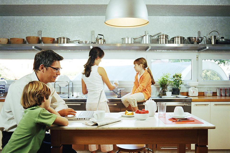 Family in kitchen, side view