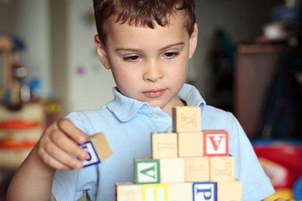 Boy stacking blocks