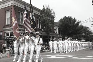 Sailors from Officer Candidate School in Newport, R.I., march at the 4th of July parade. New England Navy Week is one of 26 Navy Weeks planned across America in 2007. Navy weeks are designed to show Americans the investment they have made in the Navy and increase awareness in cities that do not have a significant Navy presence.