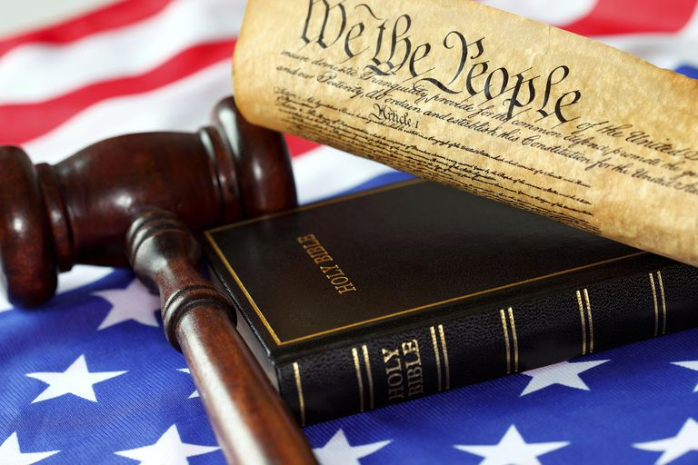 Constitution, bible, gavel and hammer