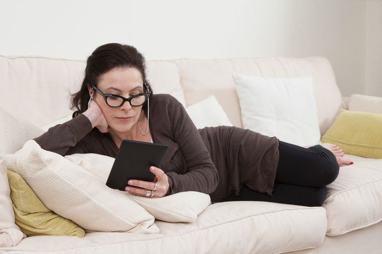 Woman reading an ebook at home
