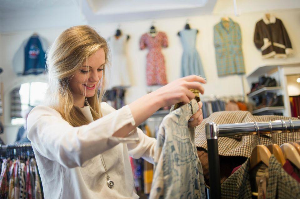 Woman looking at top garment