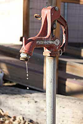 A leaking yard hydrant